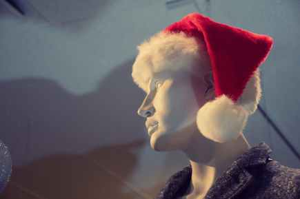 male mannequin with red santa hat